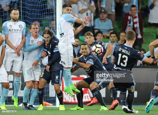 Brandon O'Neill of Sydney FC shoots and scores their second goal during the round 21 ALeague match between Melbourne City and Sydney FC at AAMI Park...