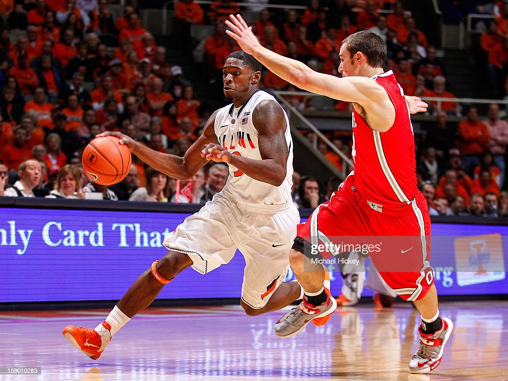 Brandon Paul #3 of the Illinois Fighting Illini dribbles the ball against <a gi-track='captionPersonalityLinkClicked' href=/galleries/search?phrase=Aaron+Craft&family=editorial&specificpeople=7348782 ng-click='$event.stopPropagation()'>Aaron Craft</a> #4 of the Ohio State Buckeyes at Assembly Hall on January 5, 2013 in Champaign, Illinois. Ilinois defeated Ohio State 74-55.