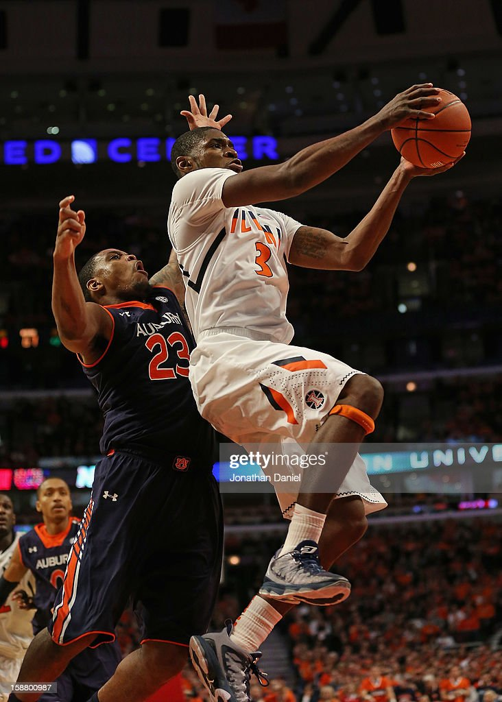 Brandon Paul #3 of the Illinois Fighting Illini drives past Frankie Sullivan #23 of the Auburn Tigers at United Center on December 29, 2012 in Chicago, Illinois. Illinois defeated Auburn 81-79.