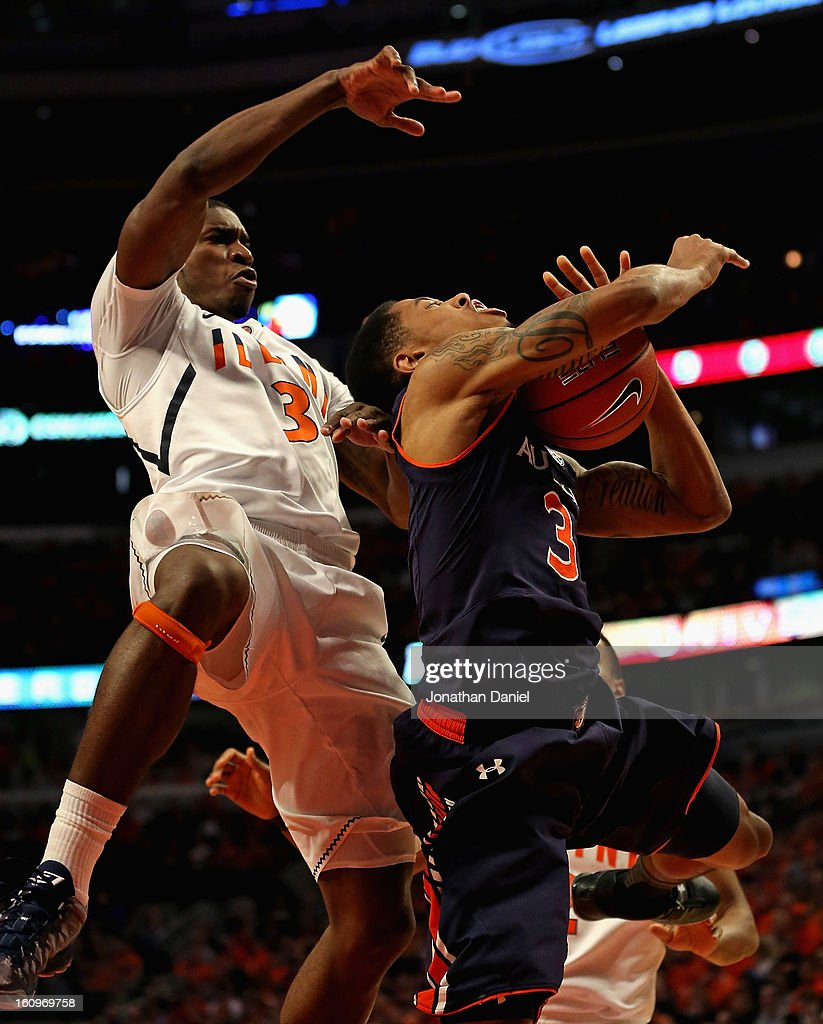 Brandon Paul #3 of the Illinois Fighting Illini fouls Chris Denson #3 of the Auburn Tigers at United Center on December 29, 2012 in Chicago, Illinois. Illinois defeated Auburn 81-79.