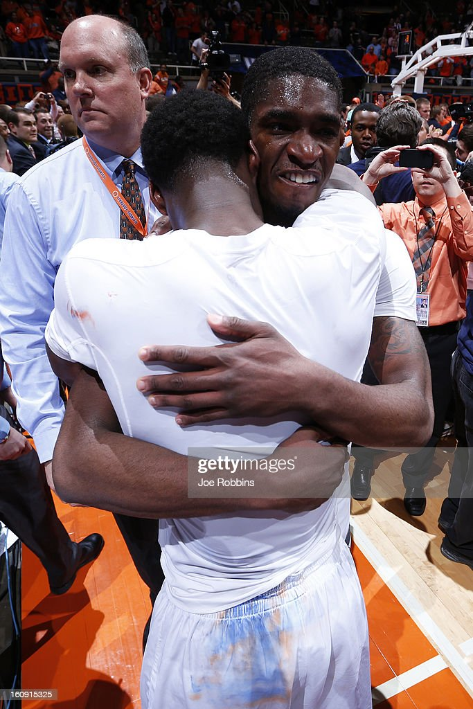 Brandon Paul #3 of the Illinois Fighting Illini hugs teammate D.J. Richardson #1 after the game against the Indiana Hoosiers at Assembly Hall on February 7, 2013 in Champaign, Illinois. Illinois defeated No. 1 ranked Indiana 74-72.