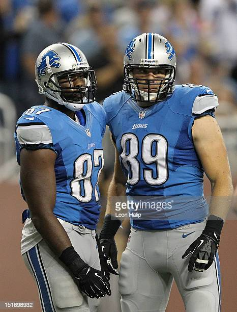 Brandon Pettigrew and Will Heller of the Detroit Lions takes a break during the season opener against the St Louis Rams at Ford Field on September 9...