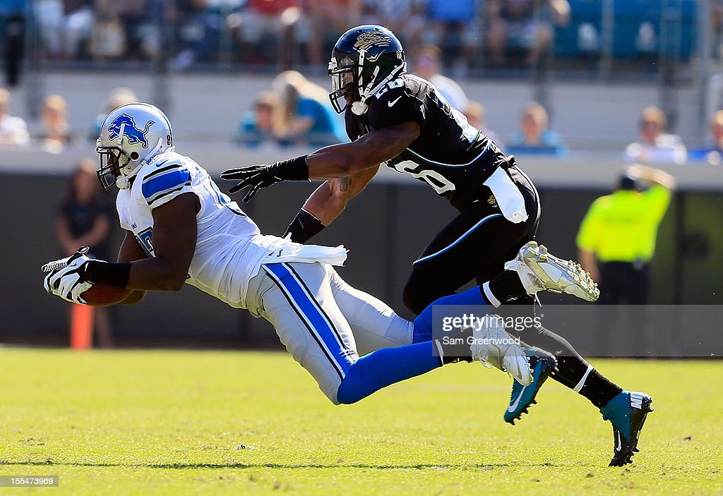 <a gi-track='captionPersonalityLinkClicked' href=/galleries/search?phrase=Brandon+Pettigrew&family=editorial&specificpeople=4061939 ng-click='$event.stopPropagation()'>Brandon Pettigrew</a> #87 of the Detroit Lions makes a reception against <a gi-track='captionPersonalityLinkClicked' href=/galleries/search?phrase=Dawan+Landry&family=editorial&specificpeople=575013 ng-click='$event.stopPropagation()'>Dawan Landry</a> #26 of the Jacksonville Jaguars during the game at EverBank Field on November 4, 2012 in Jacksonville, Florida.