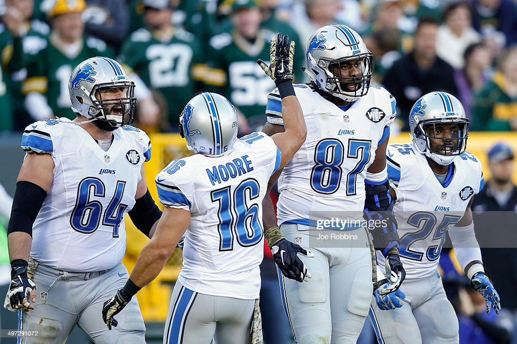 <a gi-track='captionPersonalityLinkClicked' href=/galleries/search?phrase=Brandon+Pettigrew&family=editorial&specificpeople=4061939 ng-click='$event.stopPropagation()'>Brandon Pettigrew</a> #87 of the Detroit Lions reacts with teammates <a gi-track='captionPersonalityLinkClicked' href=/galleries/search?phrase=Travis+Swanson&family=editorial&specificpeople=7341175 ng-click='$event.stopPropagation()'>Travis Swanson</a> #64, <a gi-track='captionPersonalityLinkClicked' href=/galleries/search?phrase=Lance+Moore&family=editorial&specificpeople=748984 ng-click='$event.stopPropagation()'>Lance Moore</a> #16 and <a gi-track='captionPersonalityLinkClicked' href=/galleries/search?phrase=Theo+Riddick&family=editorial&specificpeople=6235084 ng-click='$event.stopPropagation()'>Theo Riddick</a> #25 after scoring a touchdown in the third quarter against the Green Bay Packers at Lambeau Field on November 15, 2015 in Green Bay, Wisconsin.