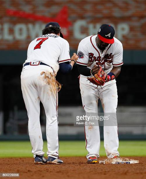 Brandon Phillips and Dansby Swanson of the Atlanta Braves celebrate after their 54 win over the Milwaukee Brewers at SunTrust Park on June 23 2017 in...