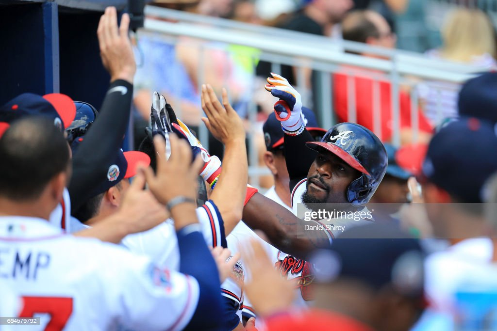 Brandon Phillips #4 of the Atlanta Braves celebrates a solo home run during the eighth inning against the New York Mets at SunTrust Park on June 10, 2017 in Atlanta, Georgia.
