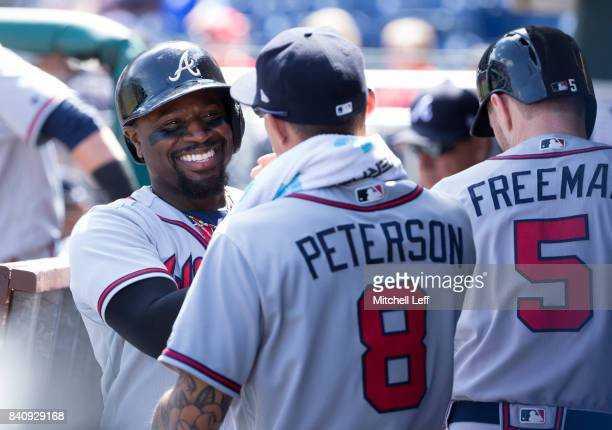 Brandon Phillips of the Atlanta Braves celebrates with Jace Peterson against the Philadelphia Phillies in the top of the first inning after scoring a...