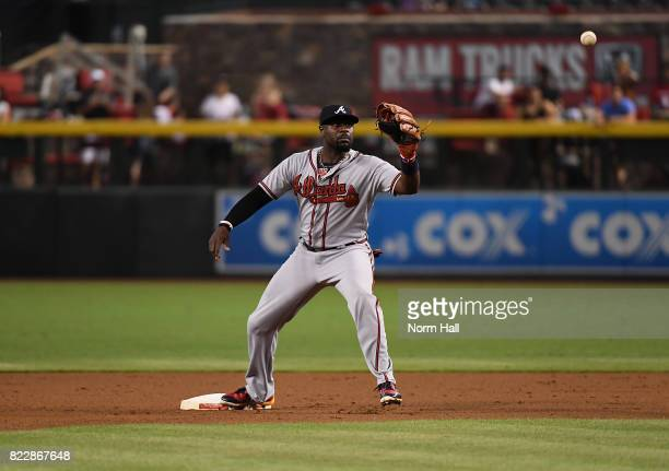 Brandon Phillips of the Atlanta Braves gets ready to catch a throw while covering second base against the Arizona Diamondbacks at Chase Field on July...