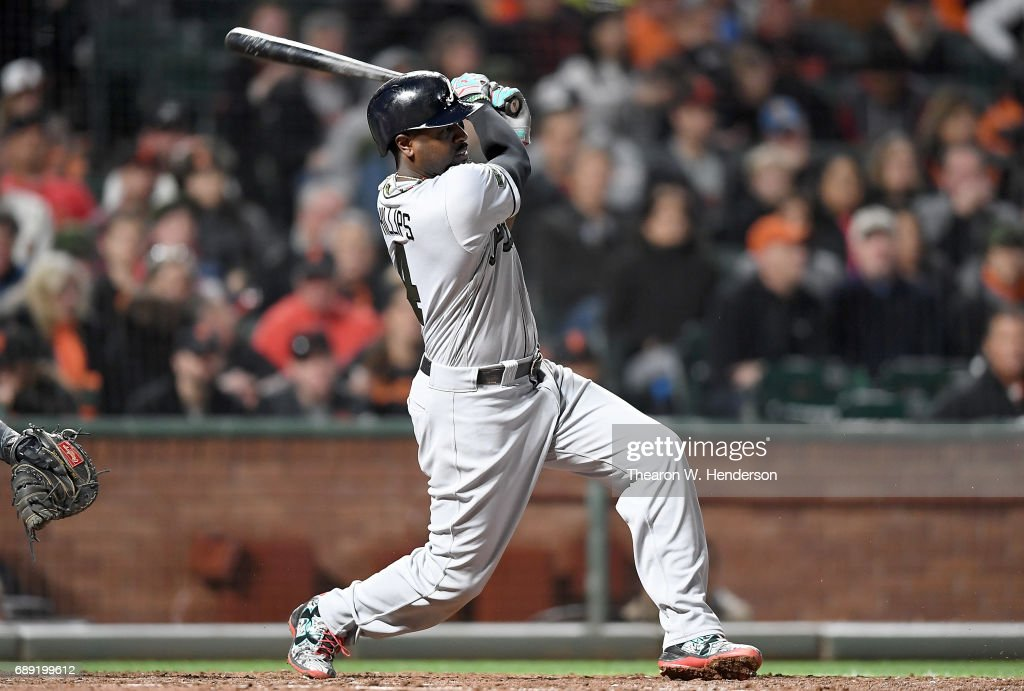 Brandon Phillips #4 of the Atlanta Braves hits an rbi single to score Rio Ruiz #14 against the San Francisco Giants in the top of the eighth inning at AT&T Park on May 27, 2017 in San Francisco, California.