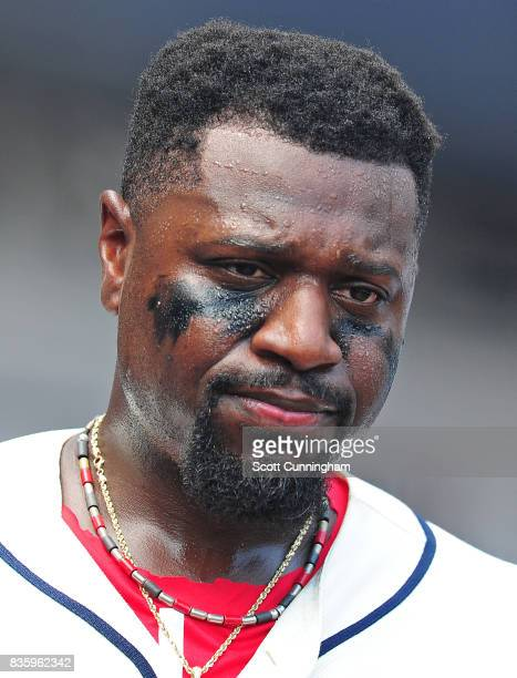 Brandon Phillips of the Atlanta Braves relaxes in the dugout after scoring a third inning run against the Cincinnati Reds at SunTrust Park on August...