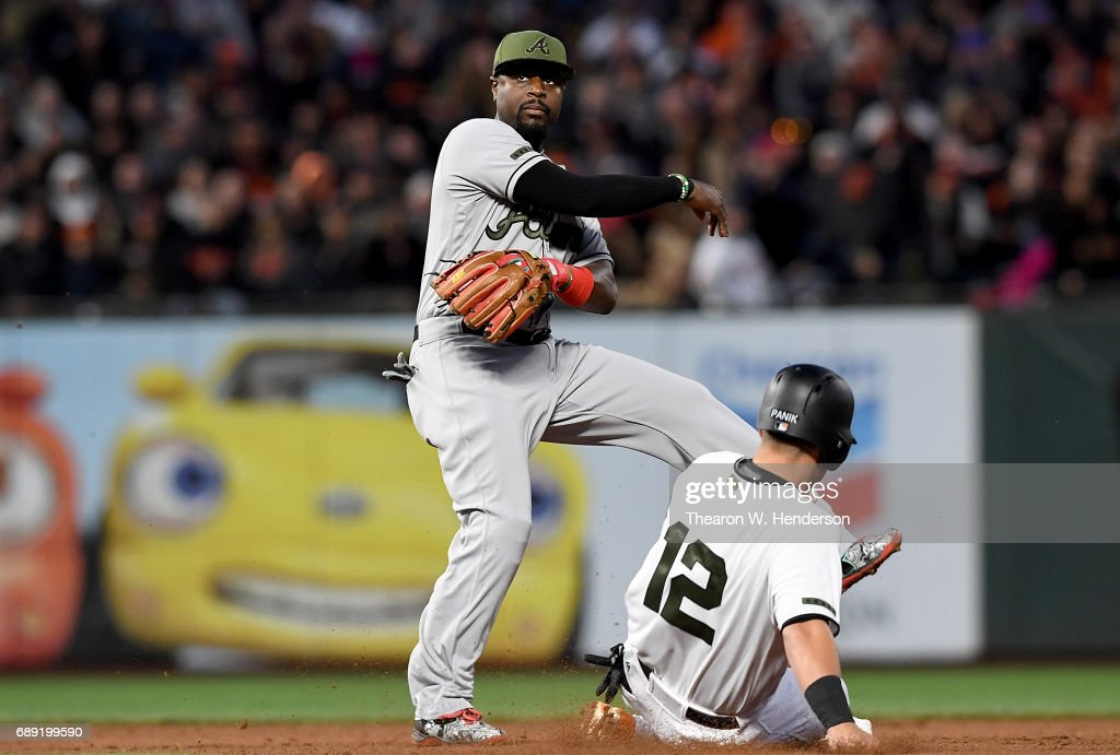 Brandon Phillips #4 of the Atlanta Braves throws over the top of Joe Panik #12 of the San Francisco Giants to complete the double-play in the bottom of the fifth inning at AT&T Park on May 27, 2017 in San Francisco, California.