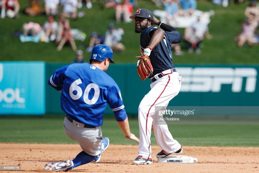 Brandon Phillips #4 of the Atlanta Braves turns a double play against Jon Berti #60 of the Toronto Blue Jays during the spring training game at Champion Stadium on February 25, 2017 in Lake Buena Vista, Florida. The Braves defeated the Blue Jays 7-4.