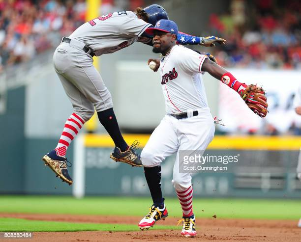 Brandon Phillips of the Atlanta Braves turns a first inning double play against Josh Reddick of the Houston Astros at SunTrust Park on July 4 2017 in...