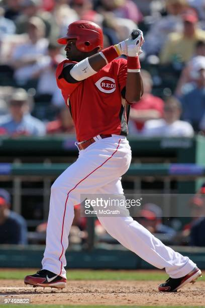 Brandon Phillips of the Cincinnati Reds at bat against the Cleveland Indians during a spring training game at Goodyear Ballpark on March 5 2010 in...