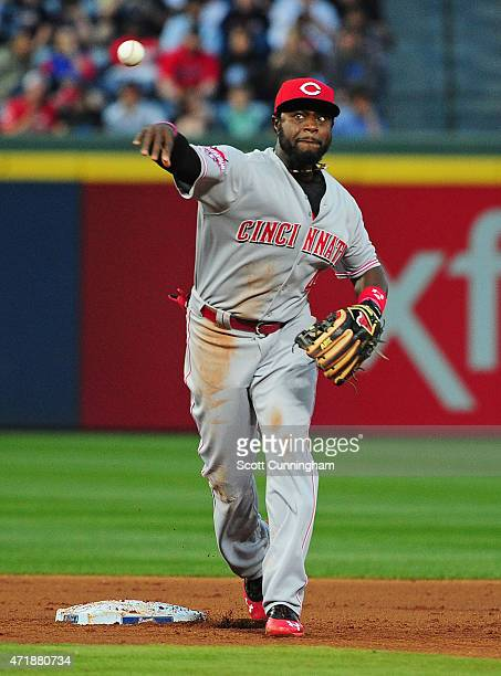 Brandon Phillips of the Cincinnati Reds attempts to turn a second inning double play against the Atlanta Braves at Turner Field on May 1 2015 in...