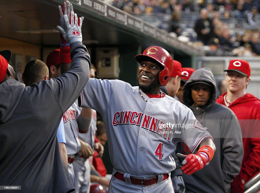 Brandon Phillips #4 of the Cincinnati Reds celebrates after hitting a solo home run in the second inning against the Pittsburgh Pirates during the game on April 12, 2013 at PNC Park in Pittsburgh, Pennsylvania.