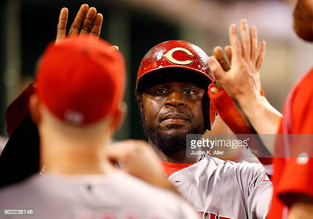 Brandon Phillips of the Cincinnati Reds celebrates after scoring on a RBI single in the fourth inning during the game against the Pittsburgh Pirates...
