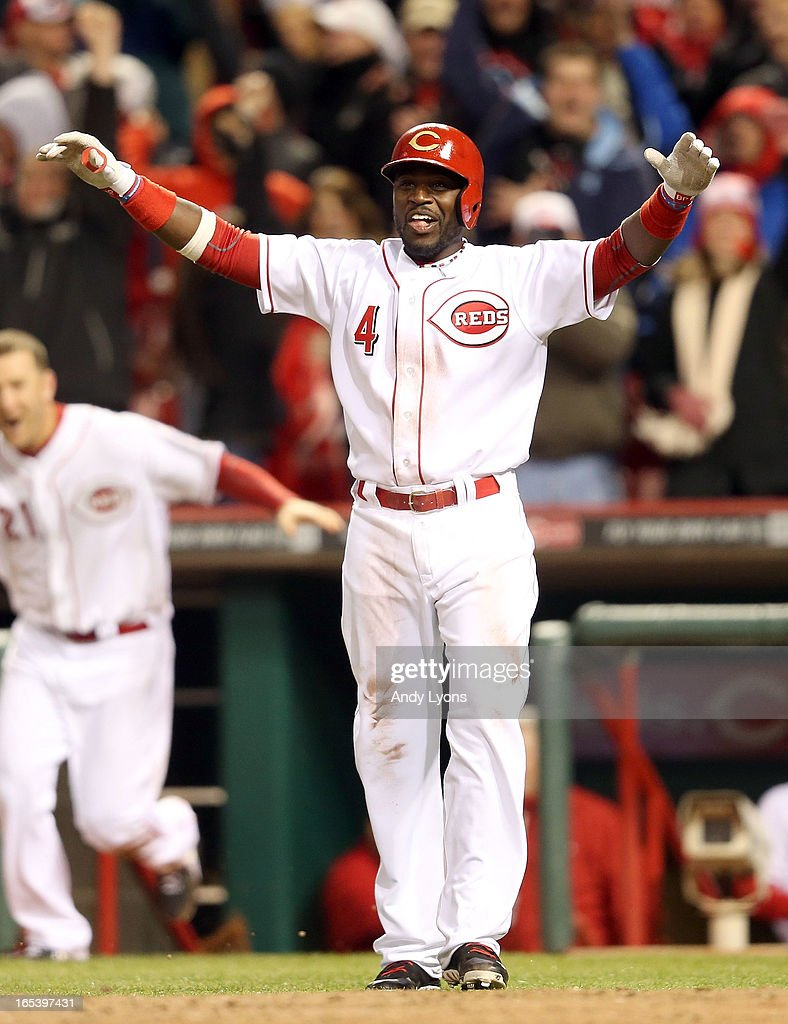 Brandon Phillips #4 of the Cincinnati Reds celebrates after Shin-Soo Choo scored the winning run in the 9th inning against the Los Angeles Angels of Anaheim at Great American Ball Park on April 3, 2013 in Cincinnati, Ohio. The Reds won 5-4.