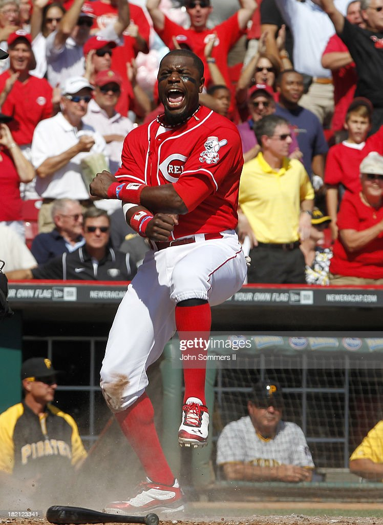 Brandon Phillips #4 of the Cincinnati Reds celebrates at home plate after scoring against the Pittsburgh Pirates at Great American Ball Park on September 28, 2013 in Cincinnati, Ohio.