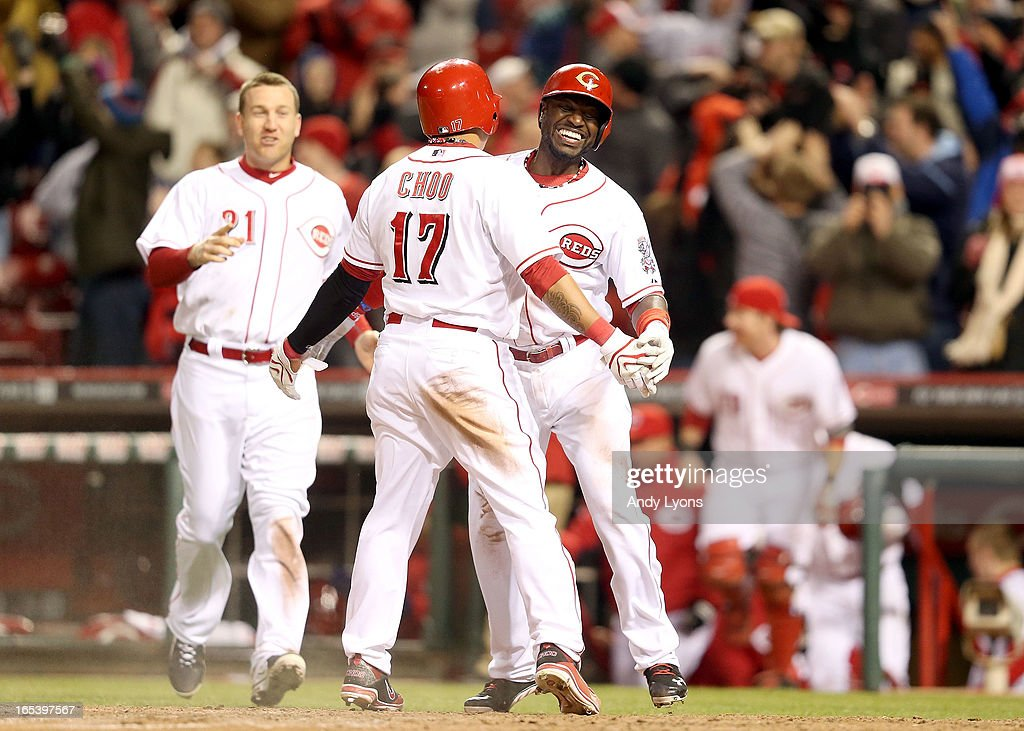 Brandon Phillips #4 of the Cincinnati Reds celebrates with <a gi-track='captionPersonalityLinkClicked' href=/galleries/search?phrase=Shin-Soo+Choo&family=editorial&specificpeople=196543 ng-click='$event.stopPropagation()'>Shin-Soo Choo</a> #17 after Choo scored the winning run in the 9th inning against the Los Angeles Angels of Anaheim at Great American Ball Park on April 3, 2013 in Cincinnati, Ohio. The Reds won 5-4.