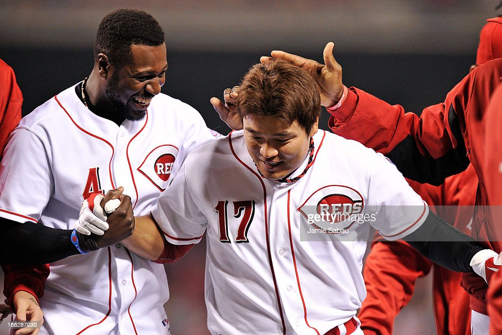 Brandon Phillips #4 of the Cincinnati Reds celebrates with <a gi-track='captionPersonalityLinkClicked' href=/galleries/search?phrase=Shin-Soo+Choo&family=editorial&specificpeople=196543 ng-click='$event.stopPropagation()'>Shin-Soo Choo</a> #17 of the Cincinnati Reds after Choo's two out ninth inning home run gave Cincinnati a 5-4 win over the Atlanta Braves at Great American Ball Park on May 7, 2013 in Cincinnati, Ohio.