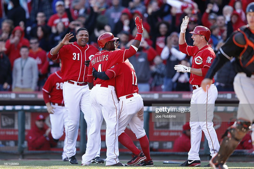 Brandon Phillips #4 of the Cincinnati Reds celebrates with teammates after hitting a sacrifice fly to win the game against the Miami Marlins at Great American Ball Park on April 20, 2013 in Cincinnati, Ohio. The Reds won 3-2 in 13 innings.