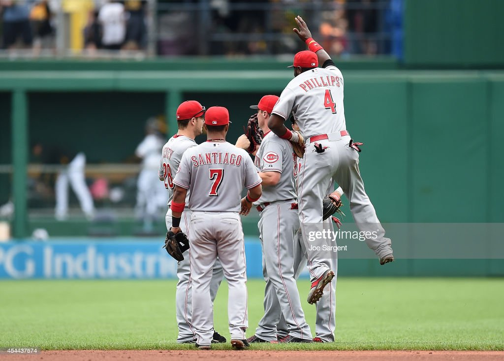 Brandon Phillips #4 of the Cincinnati Reds celebrates with teammates after a 3-2 win over the Pittsburgh Pirates on August 31, 2014 at PNC Park in Pittsburgh, Pennsylvania.