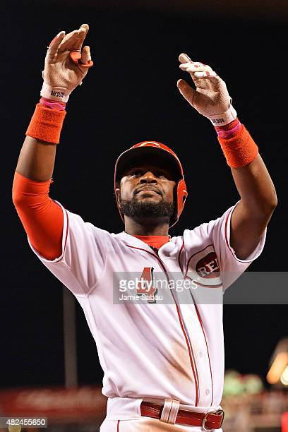 Brandon Phillips of the Cincinnati Reds celebrates with the fans after hitting his second threerun home run of the night against the Pittsburgh...