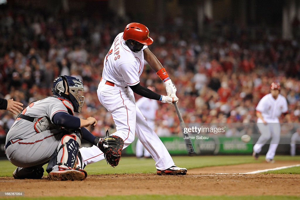<a gi-track='captionPersonalityLinkClicked' href=/galleries/search?phrase=Brandon+Phillips+-+Baseball+Player&family=editorial&specificpeople=538206 ng-click='$event.stopPropagation()'>Brandon Phillips</a> #4 of the Cincinnati Reds connects for a sacrifice fly to score a run in the eighth inning against the Atlanta Braves at Great American Ball Park on May 7, 2013 in Cincinnati, Ohio. Cincinnati defeated Atlanta 5-4.
