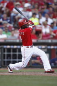 Brandon Phillips of the Cincinnati Reds connects with the pitch during the game against the Minnesota Twins at Great American Ball Park on June 23...