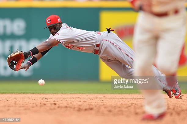 Brandon Phillips of the Cincinnati Reds dives for a ball hit by Carlos Santana of the Cleveland Indians in the eighth inning at Progressive Field on...
