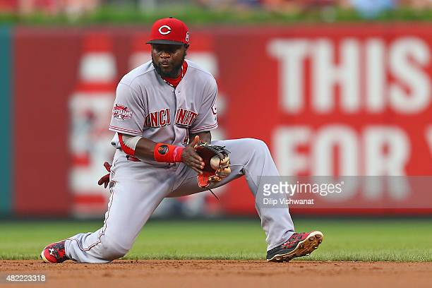 Brandon Phillips of the Cincinnati Reds fields a ground ball against the St Louis Cardinals in the first inning at Busch Stadium on July 28 2015 in...