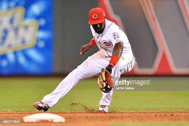 Brandon Phillips of the Cincinnati Reds fields a ground ball hit in the eighth inning by the Los Angeles Dodgers at Great American Ball Park on...