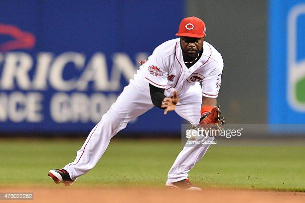 Brandon Phillips of the Cincinnati Reds fields a ground ball in the first inning against the Atlanta Braves at Great American Ball Park on May 11...