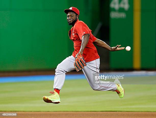 Brandon Phillips of the Cincinnati Reds flips the ball behind his back during infield practice before the Reds met the Miami Marlins at Marlins Park...
