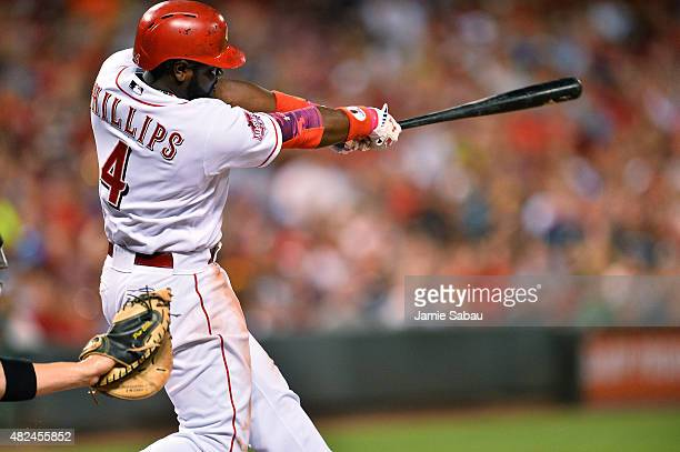 Brandon Phillips of the Cincinnati Reds follows through on his second threerun home run of the night against the Pittsburgh Pirates in the sixth...
