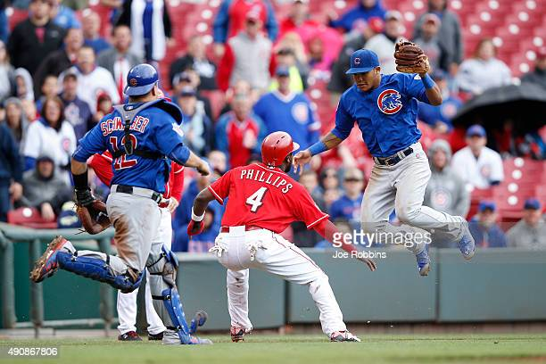 Brandon Phillips of the Cincinnati Reds gets caught off third base against Addison Russell of the Chicago Cubs in the sixth inning at Great American...