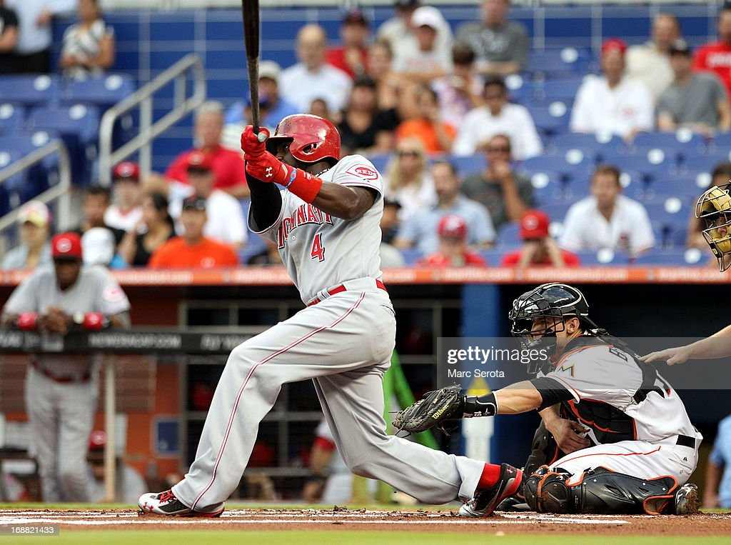 Brandon Phillips #4 of the Cincinnati Reds hits a RBI double in the first inning against the Miami Marlins at Marlins Park on May 15, 2013 in Miami, Florida.