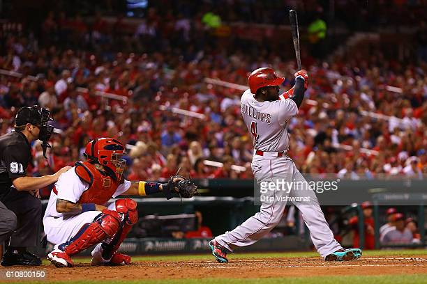 Brandon Phillips of the Cincinnati Reds hits a sacrifice fly for an RBI against the St Louis Cardinals in the third inning at Busch Stadium on...