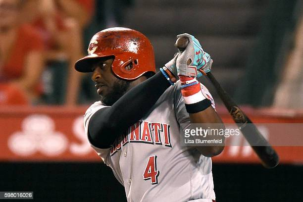 Brandon Phillips of the Cincinnati Reds hits a single in the eighth inning against the Los Angeles Angels of Anaheim at Angel Stadium of Anaheim on...