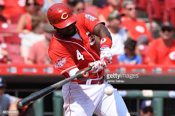 Brandon Phillips of the Cincinnati Reds hits a single in the fifth inning against the Milwaukee Brewers at Great American Ball Park on September 5...