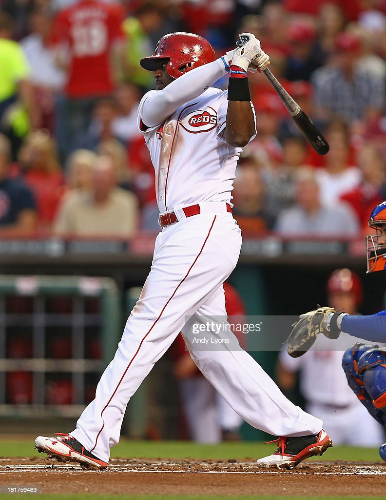 Brandon Phillips #3 of the Cincinnati Reds hits a single in the first inning against the New York Mets at Great American Ball Park on September 24, 2013 in Cincinnati, Ohio.