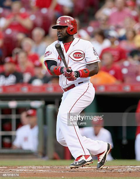 Brandon Phillips of the Cincinnati Reds hits a single in the first inning during the game against the Pittsburgh Pirates at Great American Ball Park...