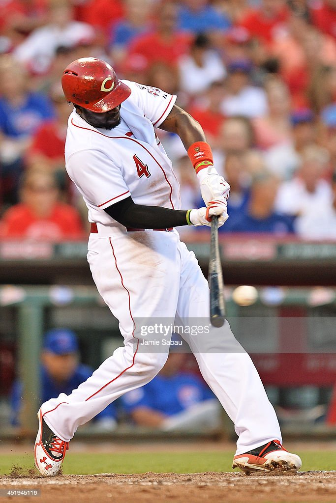 Brandon Phillips #4 of the Cincinnati Reds hits an RBI single in the fifth inning against the Chicago Cubs at Great American Ball Park on July 9, 2014 in Cincinnati, Ohio. Cincinnati defeated Chicago 4-1.