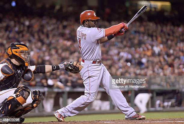 Brandon Phillips of the Cincinnati Reds hits an rbi single scoring Jay Bruce against the San Francisco Giants in the top of the seventh inning at ATT...
