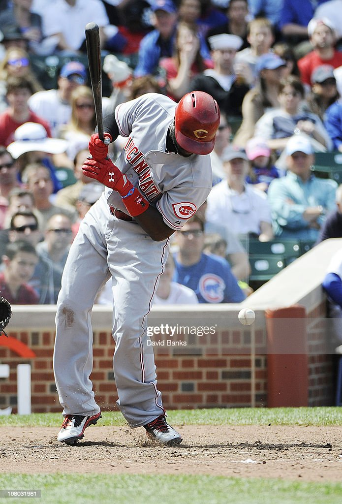 Brandon Phillips #4 of the Cincinnati Reds is hit by a pitch during the eighth inning against the Chicago Cubs on May 4, 2013 at Wrigley Field in Chicago, Illinois.