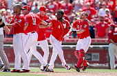 Brandon Phillips of the Cincinnati Reds is restrained by teammates after being hit by a pitch in the 8th inning against the Pittsburgh Pirates at...