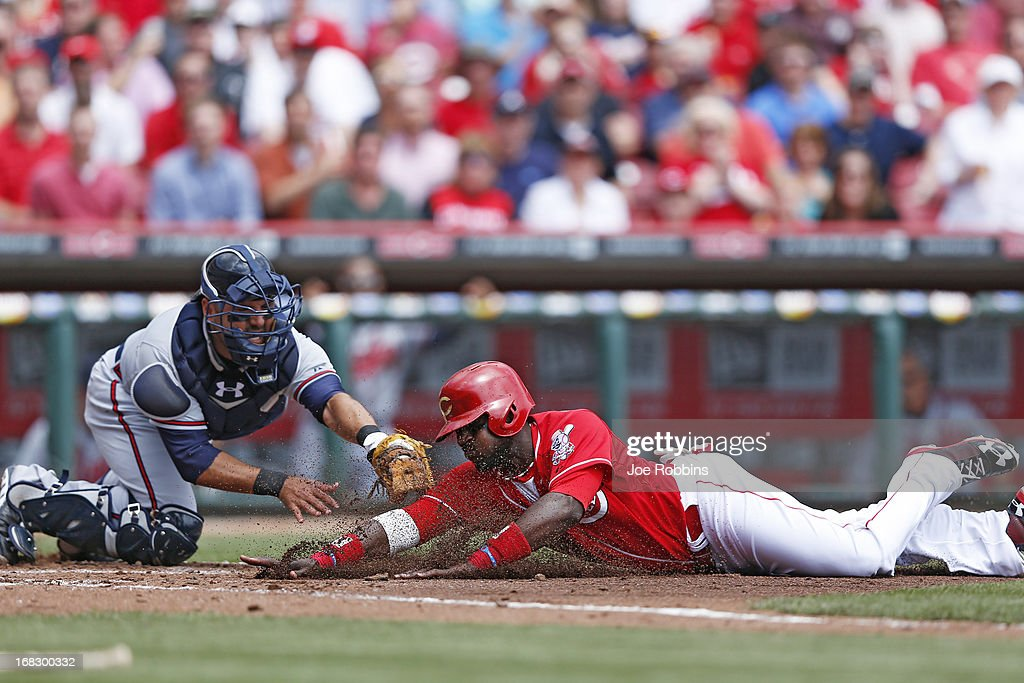Brandon Phillips #4 of the Cincinnati Reds is tagged out at home plate trying to score in the second inning by <a gi-track='captionPersonalityLinkClicked' href=/galleries/search?phrase=Gerald+Laird&family=editorial&specificpeople=228949 ng-click='$event.stopPropagation()'>Gerald Laird</a> #11 of the Atlanta Braves during the game at Great American Ball Park on May 8, 2013 in Cincinnati, Ohio.