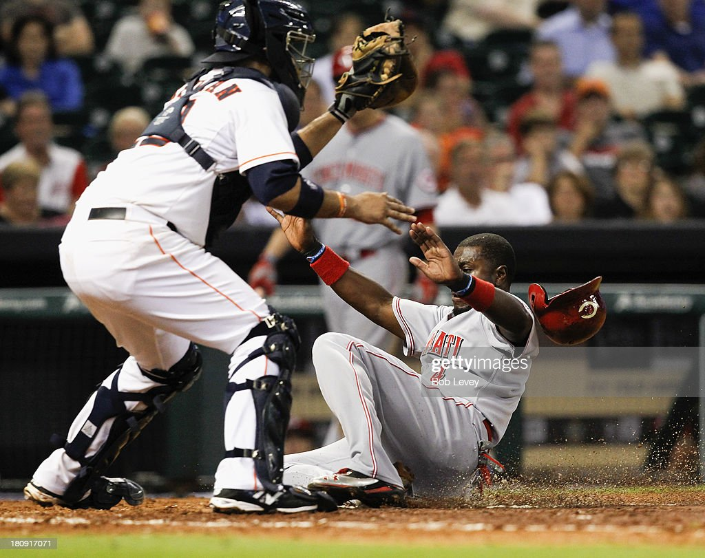 Brandon Phillips #4 of the Cincinnati Reds is tagged out by catcher <a gi-track='captionPersonalityLinkClicked' href=/galleries/search?phrase=Carlos+Corporan&family=editorial&specificpeople=5716887 ng-click='$event.stopPropagation()'>Carlos Corporan</a> #22 of the Houston Astros as he tried to score in the sixth inning at Minute Maid Park on September 17, 2013 in Houston, Texas.