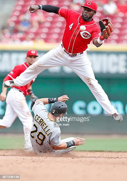 Brandon Phillips of the Cincinnati Reds is unable to catch the ball as Francisco Cervelli of the Pittsburgh Pirates safely slides into second base...